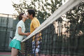 Couple kissing over the tennis net Royalty Free Stock Photo
