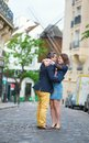 Couple kissing in paris on montmartre near a wind mill Royalty Free Stock Images