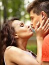 Couple kissing at park outdoor Royalty Free Stock Image