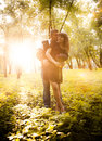 Couple kissing in park on sunset beautiful Royalty Free Stock Photography