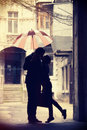 Couple kissing at patio Royalty Free Stock Images