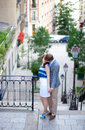 Couple kissing at the stairs on Montmartre in Paris Stock Photo