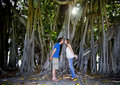 Couple kissing under tree Stock Images
