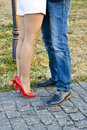 Couple kissing view of legs only Stock Image