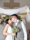 Couple kissing on wedding day at church Royalty Free Stock Photos