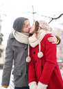 Couple kissing on winter day Royalty Free Stock Image