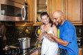Couple at the kitchen Stock Image