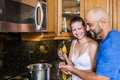 Couple at the kitchen Royalty Free Stock Image
