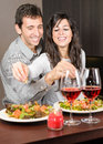 Couple in kitchen cooking together Royalty Free Stock Photo