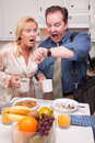 Couple in Kitchen Late for Work Stock Photography