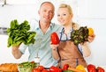 Couple kitchen raw vegetables Royalty Free Stock Photo