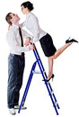Couple and ladder the tall men holding a on which climbed woman Stock Image