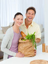 Couple laughing with shopping bags Stock Photography