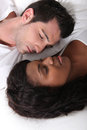 Couple laying in bed Stock Photo