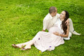 Couple lays together, hugging, pregnant woman Royalty Free Stock Photography