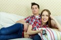 Couple at leisure portrait of young watching tv home Royalty Free Stock Photo