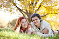 Couple lie at green grass in the park. Royalty Free Stock Photos
