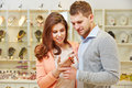 Couple looking at bracelet at smiling and other jewelry jeweler Royalty Free Stock Photography