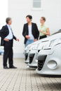 Couple looking at car on yard of dealer Stock Photos