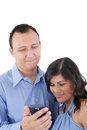 Couple looking at a cell phone Royalty Free Stock Images