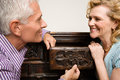 Couple looking at chest of drawers Royalty Free Stock Photo