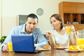 Couple looking e mail during breakfast in laptop time Royalty Free Stock Photo