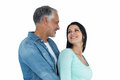 Couple looking at each other and smiling on white background Royalty Free Stock Photography