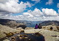 Couple looking at fjord from Kjerag area in Norway Royalty Free Stock Photo