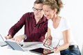 Couple looking at floor plans for new place Royalty Free Stock Photo