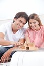 Couple looking at house model happy young Stock Photography