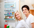 Couple looking inside the fridge Royalty Free Stock Photography