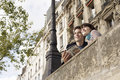 Couple looking over bridge with guidebook low angle view of a smiling Royalty Free Stock Photography