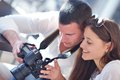 Couple looking photos on camera Royalty Free Stock Photo