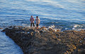 Couple looking at sea life near divers cove laguna beach california image shows a off the rocky coastline heisler park and Stock Photo