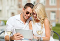 Couple looking at tablet pc in cafe summer holidays dating and technology concept the city Stock Image