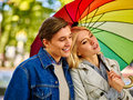 Couple in love on date under umbrella after rain. Royalty Free Stock Photo