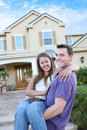Couple in Love in Front Home (Focus on Woman) Royalty Free Stock Photo