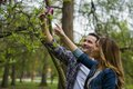 Couple in love guy wants to pick flower for a girl Royalty Free Stock Photography