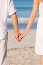 Couple in love hand in hand on beach in summer Royalty Free Stock Images