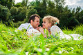 Couple in love having picnic happy young making the park Stock Photography