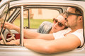 Couple in love having a rest during honeymoon vintage car trip Royalty Free Stock Photo
