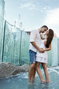 Couple in love kissing each other fountain Stock Images