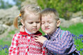 Couple in love little children on green meadow Royalty Free Stock Photo