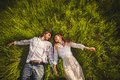 Couple in love lying on grass green Royalty Free Stock Photos