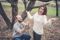 Couple in love marriage proposal at the park winter Stock Image