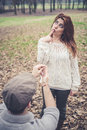 Couple in love marriage proposal at the park winter Royalty Free Stock Photography