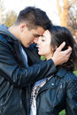 Couple in love outdoors sensual a park looking at each other Royalty Free Stock Photography