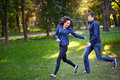 Couple in love in the park runs Stock Photography