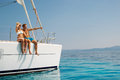 Couple in love on a sail boat in the summer with turquoise blue water Royalty Free Stock Photos