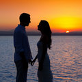Couple in love silhouette at lake sunset Royalty Free Stock Photo